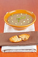 Cream of mushroom soup and bread croutons. Shallow depth of field