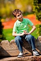 Portrait of a beautiful little boy outdoor in a park