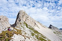 Mountaineer climbing Latemar mountain, fixed rope route, Dolomites, Latemar mountains at the back, province of Bolzano-Bozen, Italy, Europe