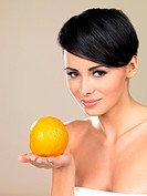 Portrait of beautiful woman, she holding fresh orange