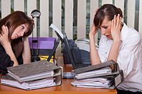 two businesswomen have stress by the work in office