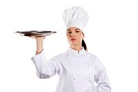 young graceful woman dressed as a cook with cap over white backgound with plate