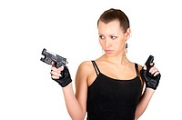 Attractive female with two small handguns isolated over white
