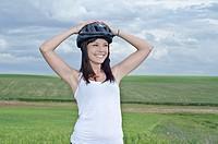 Woman biker enjoy in the ruralscape with her helmet  Aragon, Spain