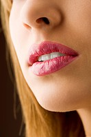close up on a woman mouth pink colored and wet lips