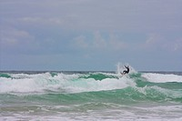 a surfer out at sea at watergate bay