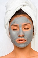 Girl with facial mask eyes are closed