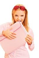 portrait of beautiful blonde girl in sunglasses jokingly biting pink folder on white
