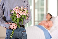 man bringing flowers to his wife