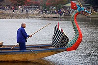 A boatman in the Arashiyama Maple Leaf Festival