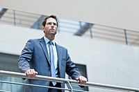 Businessman standing on balcony