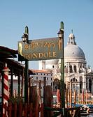 Gondola sign and santa maria della salute, venice, italy