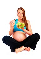 pregnant girl eats fresh vegetables