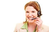 Junge lachende Frau mit einem Headset