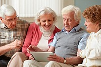 Senior adults using digital tablet