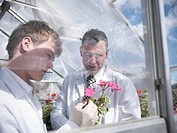 Teacher and student in greenhouse