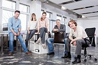 Germany, Bavaria, Munich, Men and women in office, smiling, portrait