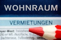 German apartment listings, housing advertisements and a red coloured pencil, housing shortage