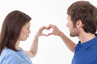 Couple making heart shape