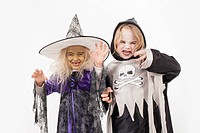Brother and sister in fancy dress costume for halloween