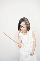 Frowning girl holding stick