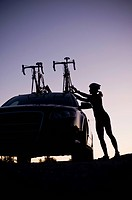 Mountain biker attaching bikes to car