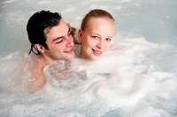 One man with woman in jacuzzi at a spa