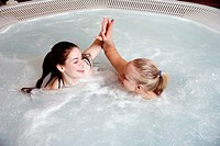 Two young women in jacuzzi at a spa