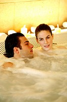One man with woman in jacuzzi at a spa (thumbnail)