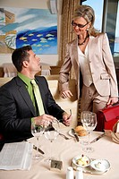 Businessman and businesswoman meeting in a restaurant