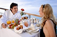 Couple having breakfast on hotel terrace