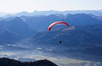 Austria, Person paragliding over Schafberg Mountain
