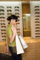 Woman shopping in sunglasses store