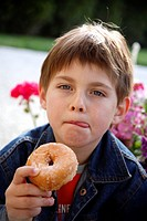 Young boy eating a doughnut