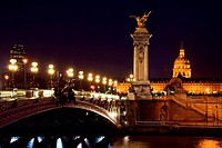 The Alexander III bridge and the dome of the Invalides at night _ Paris, France
