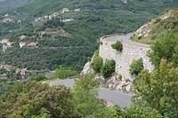 Italy, Liguria, Province of Savona, Mature man riding bicycle