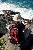 Hiker filming with a home video camera, Punta Suarez, Espanola Island, Galapagos Islands, Ecuador