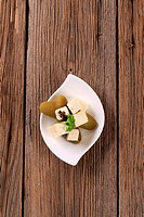 Marinated feta cheese and pickles _ overhead