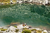 Austria, Styria, Man and woman having rest at Lake Obersee