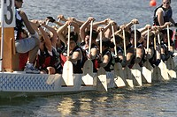 dragon boat racing in Vancouver British Columbia. There are up to 22 people in a boat. Dragon boat racing is largely used as a team building activitey...