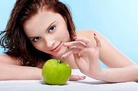 beautiful healthy serene girl with green apple