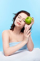 beautiful healthy serene girl with green apple