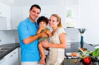 a happy young family in kitchen