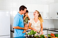 a happy family in kitchen cooking together