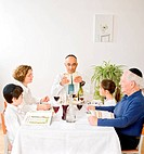 jewish family in seder celebrating passover