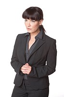 Studio portrait of middle aged Caucasian businesswoman looking serious and listening on white background