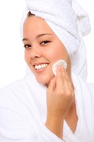 Fresh and Beautiful woman wearing white towel on her head cleaning face