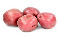 Tubers of red potatoes over white background.