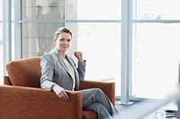 Portrait of confident businesswoman in armchair