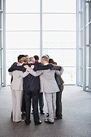 Business people standing in huddle